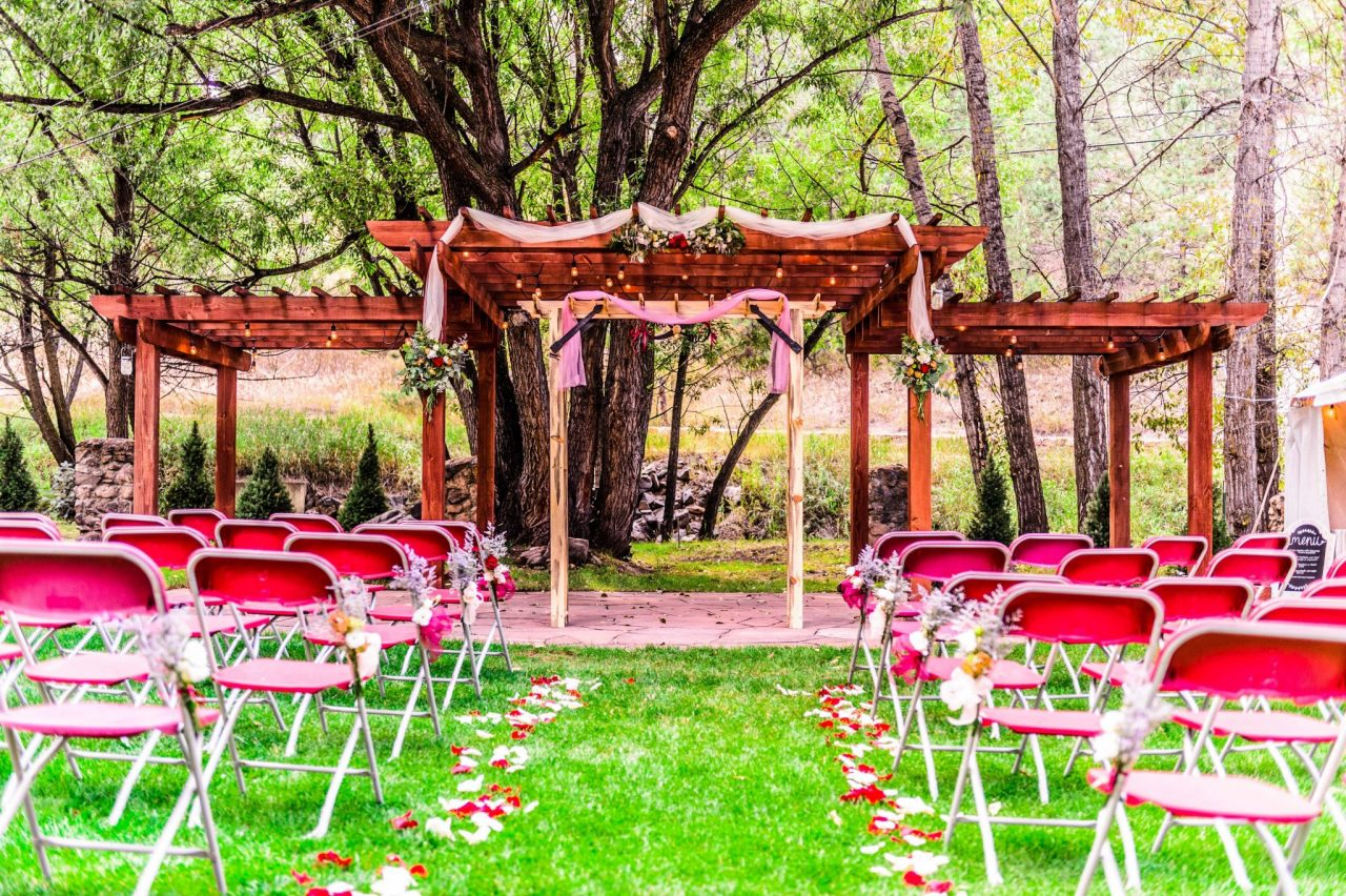 Chairs set up in front of the pergola