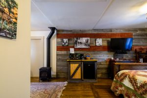 Farmhouse Room Fireplace and Kitchenette