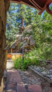 View of Hot Tub and Boulders From Farmhouse Room Entrance