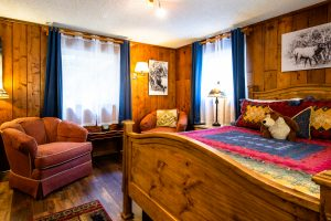 Queen Bed and Comfy Chairs in Bountiful Cabin